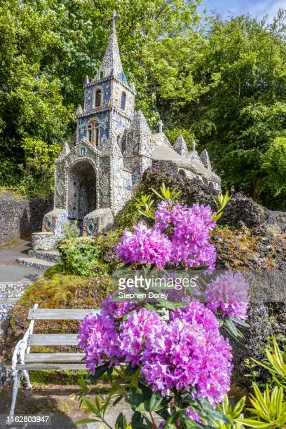the little chapel decorated with shells and broken pottery in les vauxbelets valley, guernsey, channel islands uk - chapel stock pictures, royalty-free photos & images