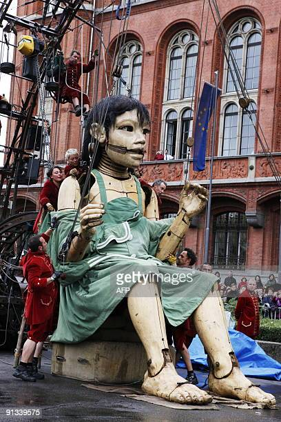 The Little Giantess of the French theatre company Royal de Luxe is dressed in front of Berlin's City hall on October 2 2009 on the first day of the...