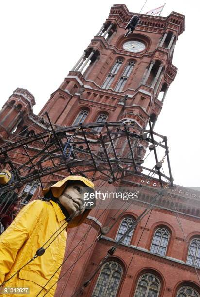 The Little Giantess of the French theatre company Royal de Luxe takes her first steps in front of Berlin's City hall on October 2 2009 on the first...