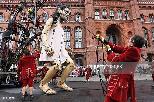 The Little Giantess of the French theatre company Royal de Luxe stands up in front of Berlin's City hall on October 2 2009 on the first day of the...