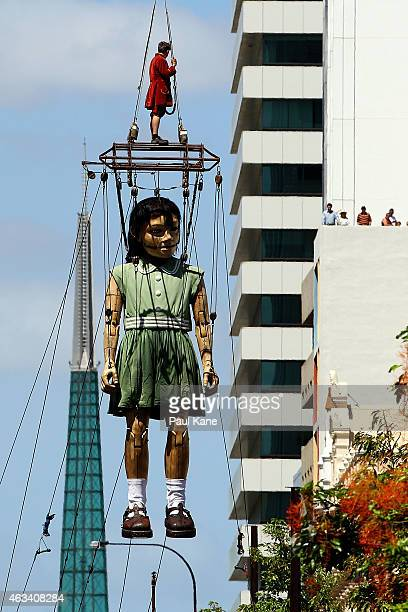 The Little Girl Giant is lifted from her boat on Barrack Street during the Perth International Arts Festival on February 14 2015 in Perth Australia