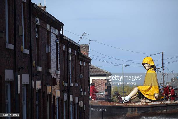 The Little Girl Giant Marionette makes it's way through the streets of Liverpool as the Titanic Sea Odyssey giant puppet spectacular gets underway on...