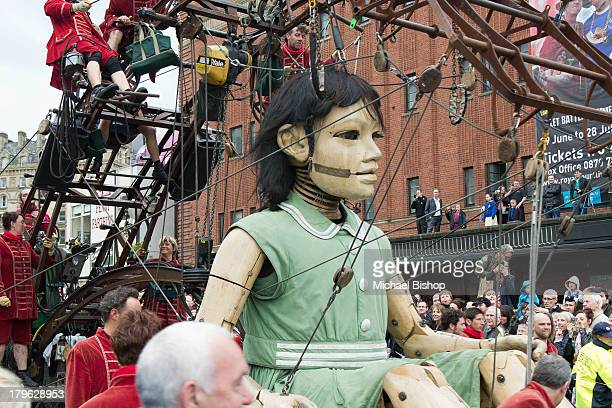 The 'Little Girl' giant passing the Royal Court Theatre in Liverpool, as part of Royal De Luxe's 'Sea Odyssey' spectacular in 2012. The most...