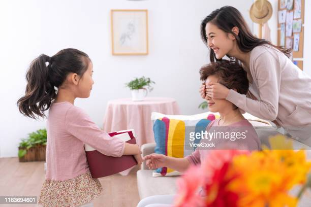 the little girl gifts to my grandmother - chinese mothers day stock pictures, royalty-free photos & images