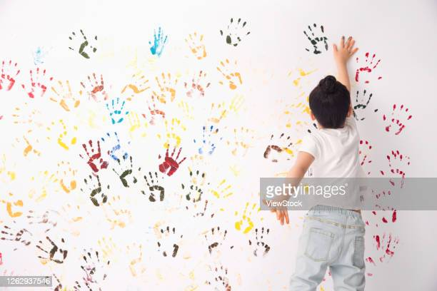 the little girl hand painted paints - finger painting stock pictures, royalty-free photos & images