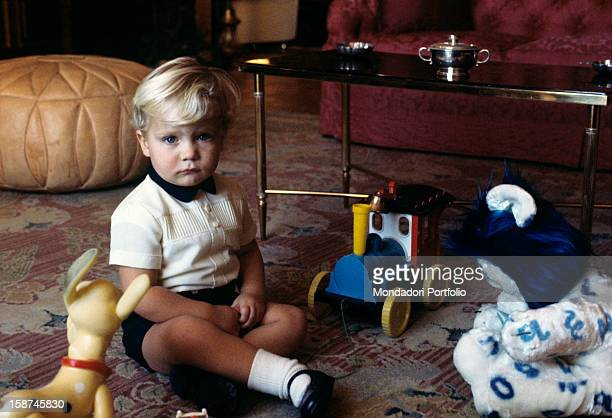 The little Infant Felipe son of the princes of Spain Juan Carlos and Sophia seats on the carpet of the sitting room in his family's residence in...