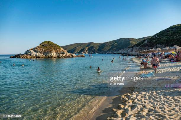 The little island near the shore of Kalamitsi. Crowd of tourists at the popular and famous beach of Kalamitsi located on the southern tip of Sithonia...