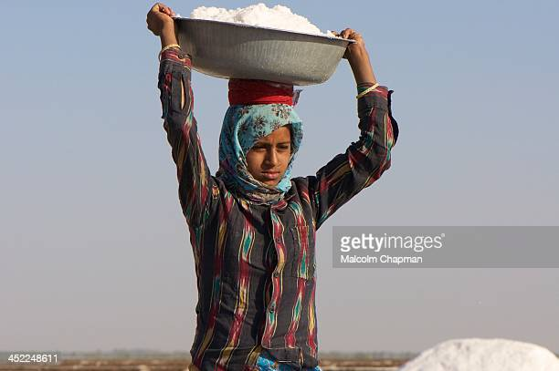 The Little Rann of Kutch is famous for its unique salt-pans where salt is harvested by local tribes. Unidentified Indian female salt worker in Little...