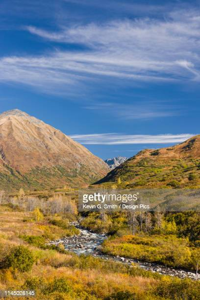 the little susitna river runs through mountains in hatcher pass, blue sky in the background, south-central alaska - mt. susitna stock pictures, royalty-free photos & images
