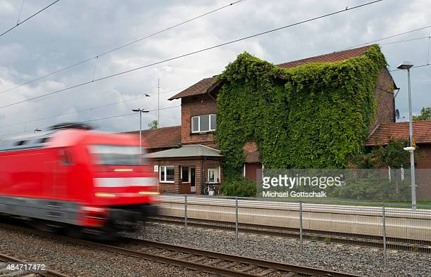 The little train station in the village of Leschede in Lower Saxony while a train fahert over on a track before on August 15 2015 in Leschede Germany