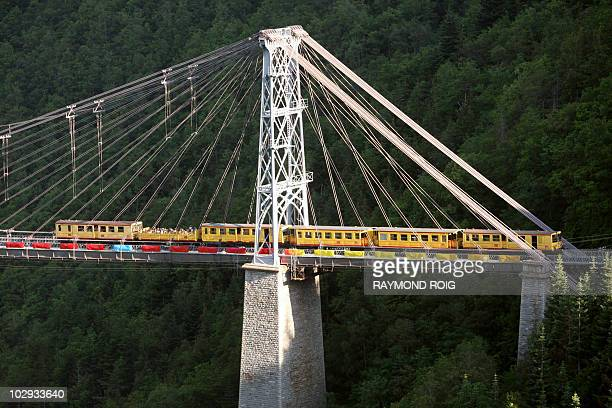 LE TRAIN JAUNE DES PYRENEES TER PAS COMME LES AUTRES FETE SES 100 ANS The little yellow train crosses a bridge on July 13 2010 near FontRomeu...