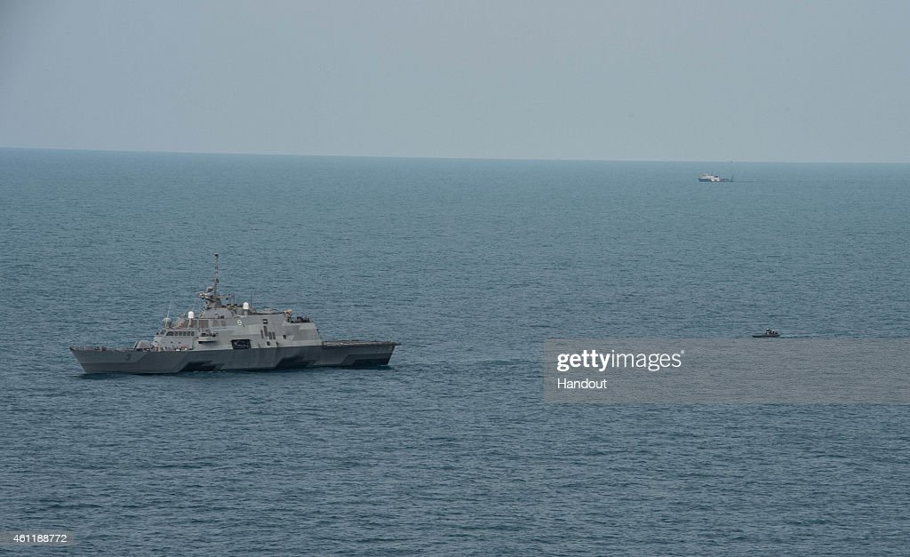 The littoral combat ship USS Fort Worth (LCS 3), with its 11-meter rigid-hull inflatable boat trailing behind, conducts visual and subsurface searches on January 7, 2015 in the Java Sea. The U.S. Navy is supporting the Indonesian-led AirAsia flight QZ8501 search efforts. AirAsia announced that flight QZ8501 from Surabaya to Singapore, with 162 people on board, lost contact with air traffic control at 07:24 a.m. local time on December 28.
