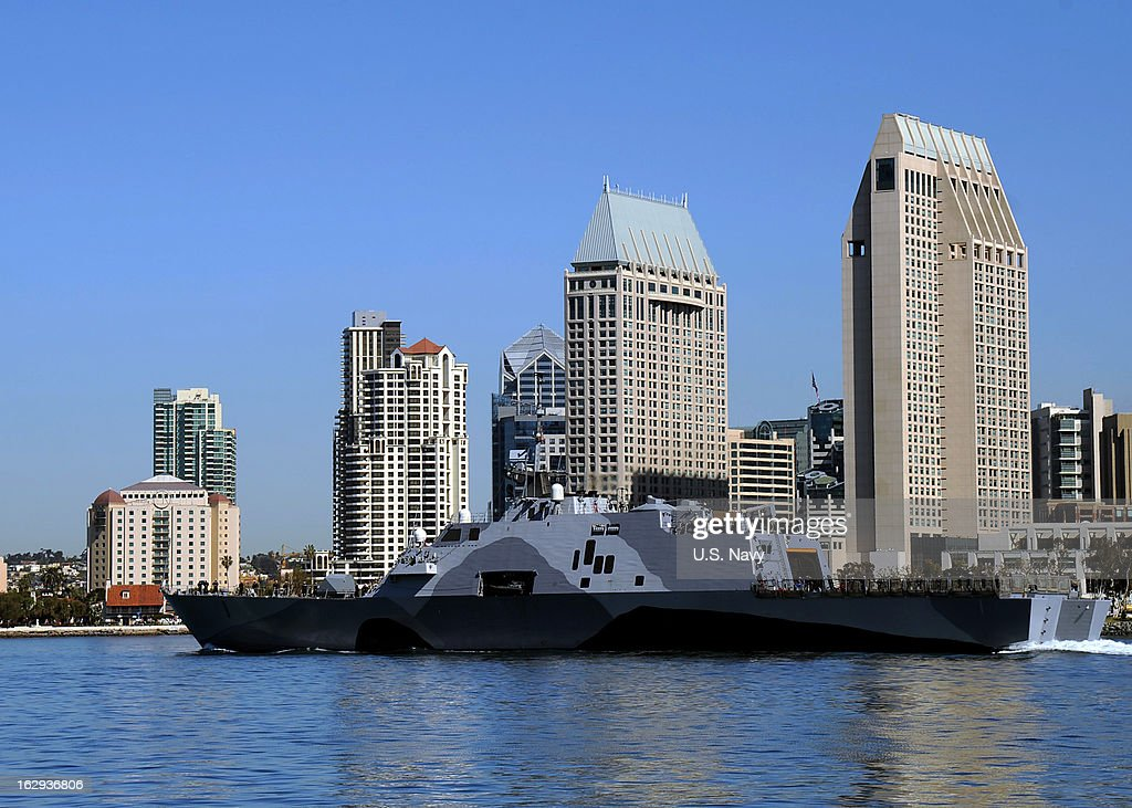 The littoral combat ship USS Freedom (LCS 1) departs San Diego Bay for deployment to the Asia-Pacific region March 1, 2013 in San Diego, California . Freedom will demonstrate her operational capabilities and allow the Navy to evaluate crew rotation and maintenance plans. LCS platforms are designed to employ modular mission packages that can be configured for three separate purposes: surface warfare, anti-submarine warfare or mine countermeasures.