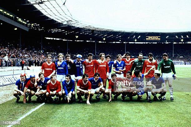 The Liverpool and Everton teams pose together for a photograph after the Milk Cup Final at Wembley Stadium on March 28 1984 in London England