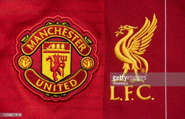 The Liverpool and Manchester United club crests on their first team home shirts on May 4 2020 in Manchester England