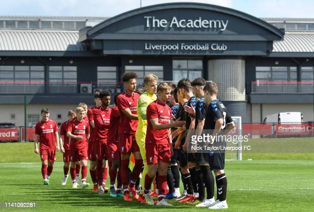 The Liverpool and Middlesbrough players shake hands at the start of the U18 Premier League game at The Kirkby Academy on May 4 2019 in Kirkby England