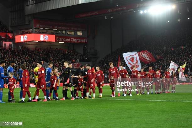 The Liverpool and Shrewsbury Town players shake hands prior to the FA Cup Fourth Round Replay match between Liverpool FC and Shrewsbury Town at...