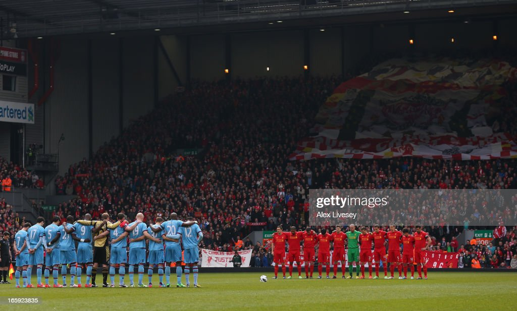 The Liverpool and West Ham United players acknowledge a minutes silence for the victims of the Hillsborough disaster prior to the Barclays Premier League match between Liverpool and West Ham United at Anfield on April 7, 2013 in Liverpool, England.