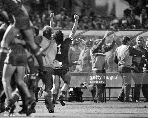 The Liverpool bench that includes coaches Roy Evans Chris Lawler Tom Saunders manager Joe Fagan as well as captain Graeme Souness all going wild with...