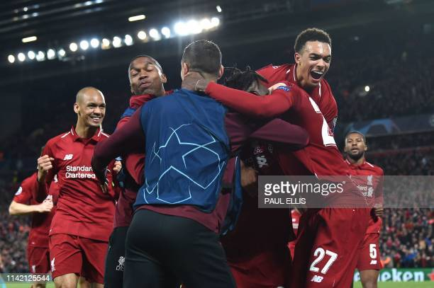 The Liverpool celebrate after scoring their fourth goal during the UEFA Champions league semifinal second leg football match between Liverpool and...