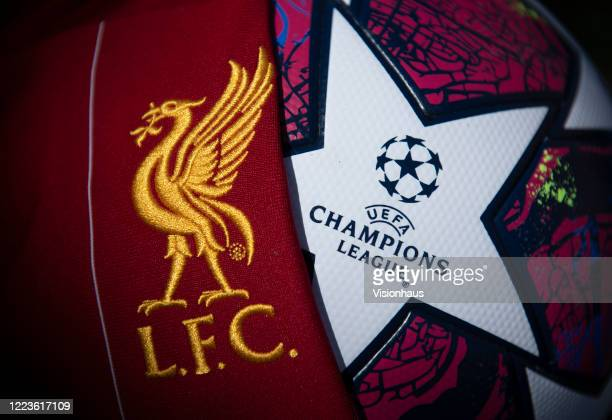 The Liverpool club crest on the first team home shirt displayed with a UEFA Champions League match ball on May 5 2020 in Manchester England