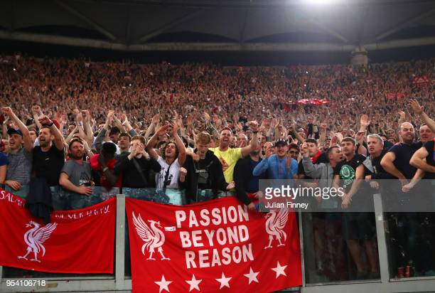 The Liverpool fans celebrate at full time during the UEFA Champions League Semi Final Second Leg match between AS Roma and Liverpool at Stadio...