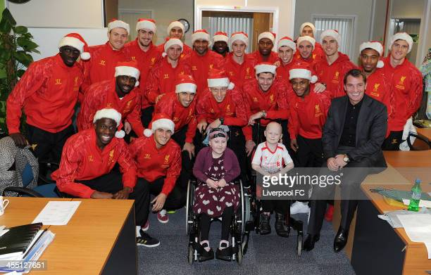 The Liverpool FC first team visit patients at Alder Hey Children's Hospital on December 11 2013 in Liverpool England