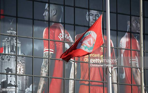 The Liverpool FC flag hangs at half mast as fans arrive in Anfield for a memorial service marking the 25th anniversary of the Hillsborough Disaster...