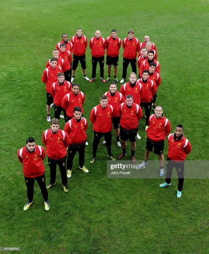 The Liverpool first team pose in the shape of the 'aids ribbon' as part of Standard Chartered's activity in support of World Aids Day on December 1st, at Melwood training camp before training on November 6, 2012 in Liverpool, England.