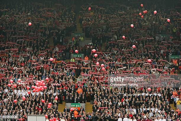 The Liverpool Kop End sing 'You'll Never Walk Alone as red balloons for each of the 96 Hillsborough victims are released during the Hillsborough...
