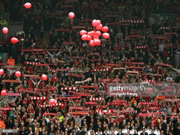 The Liverpool Kop End sing 'You'll Never Walk Alone' as red balloons for each of the 96 Hillsborough victims are released during the Hillsborough...