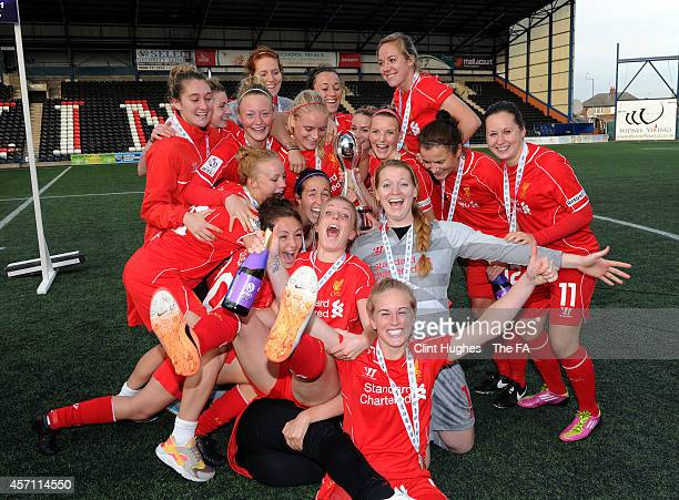 The Liverpool Ladies team celebrate with the WSL trophy up after their victory during the FA WSL 1 match between Liverpool Ladies FC and Bristol...