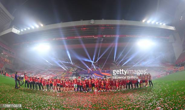 """The Liverpool line up to sing """"You'll Never Walk Alone"""" in front of the Kop as they celebrate winning the League during the presentation ceremony of..."""