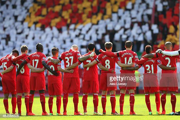 The Liverpool players acknowledge a minutes silence for the Hillsborough victims on the 25th anniversary of the tragedy prior to the Barclays Premier...