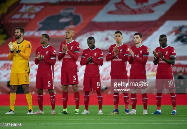 The Liverpool players Alisson Becker, Georginio Wijnaldum, Fabinho, Naby Keita, Roberto Firmino, Andy Robertson and Sadio Mane join in with a minutes...
