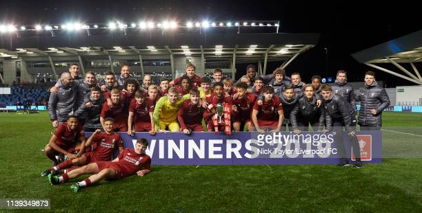 The Liverpool players and staff pose with the trophy after victory in the FA Youth Cup Final at Manchester City Football Academy on April 25, 2019 in...