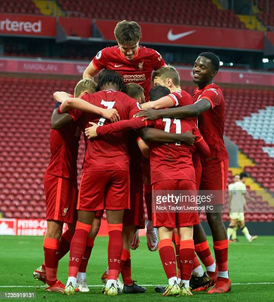 The Liverpool players celebrate James Norris scoring Liverpool's third goal during the PL2 game at Anfield on October 17, 2021 in Liverpool, England.