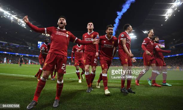 The Liverpool players celebrates after their sides first goal during the UEFA Champions League Quarter Final Second Leg match between Manchester City...