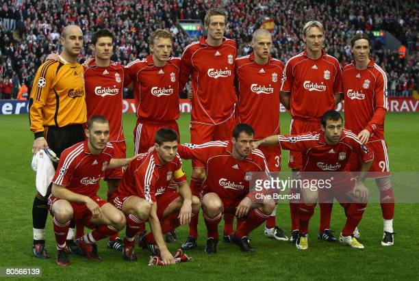 The Liverpool players line up for a team photo prior to the UEFA Champions League Quarter Final second leg match between Liverpool and Arsenal at...