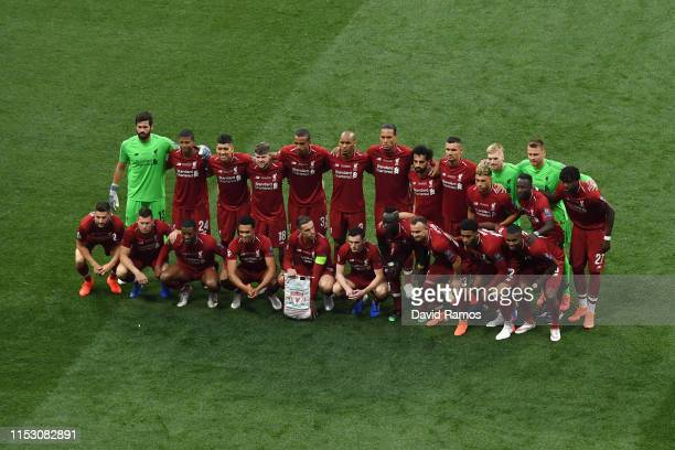 The Liverpool players line up prior to the UEFA Champions League Final between Tottenham Hotspur and Liverpool at Estadio Wanda Metropolitano on June...