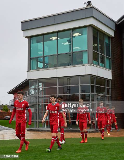The Liverpool players make their way to the pitch at Melwood Training Ground on November 21, 2020 in Liverpool, England.
