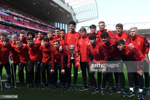 The Liverpool Reserves and Academy team pose with the FA Youth Cup at the end of the English Premier League football match between Liverpool and...