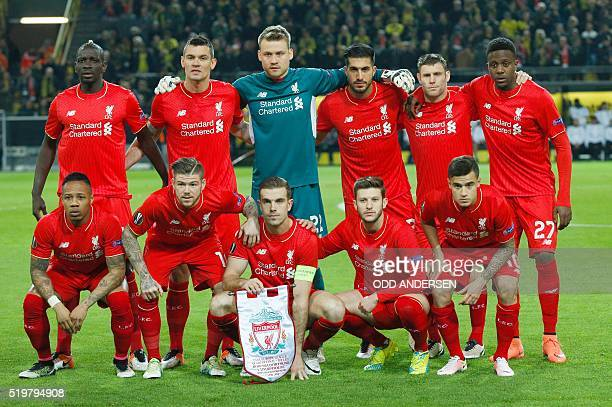 The Liverpool starting eleven back row Liverpool's French defender Mamadou Sakho Liverpool's Croatian defender Dejan Lovren Liverpool's Belgian...