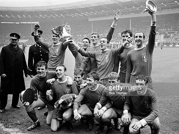 The Liverpool team back row left to right Ron Yeats Gordon Milne Willie Stevenson Ian St John Chris Lawler and Gerry Byrne front row left to right...