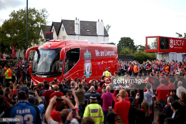 The Liverpool team bus arrives at the stadium prior to the UEFA Champions League Qualifying PlayOffs round second leg match between Liverpool FC and...