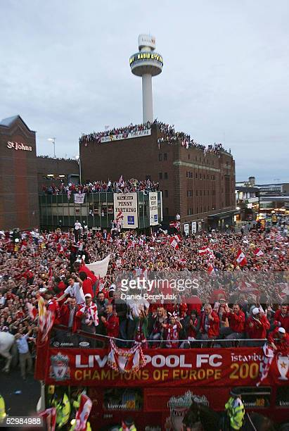 The Liverpool team bus weaves its way through thousands of fans during the Liverpool homecoming victory street Parade at St George's Hall on May 26...