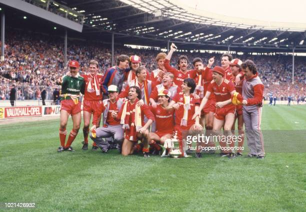 The Liverpool team celebrate after the FA Cup Final between Liverpool and Everton at Wembley Stadium on May 10 1986 in London England Back row Bruce...
