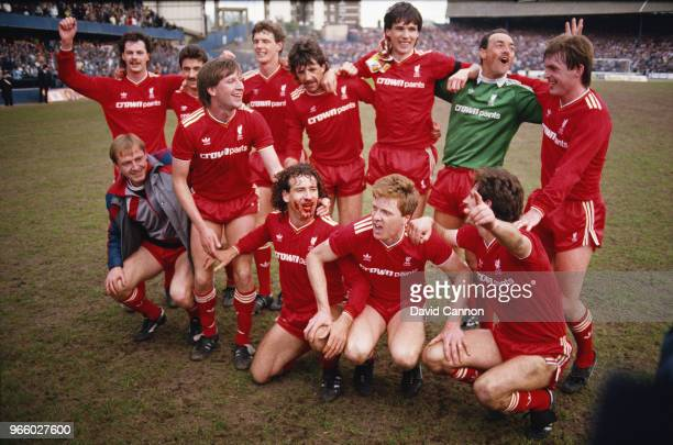 The Liverpool team celebrate after winning the 1985/1986 First Division title after beating Chelsea 10 at Stamford Bridge on May 3 1986 in London...