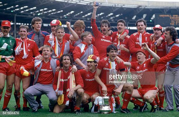 The Liverpool team celebrating with the trophy after their victory over Everton in the FA Cup Final at Wembley Stadium in London 10th May 1986...