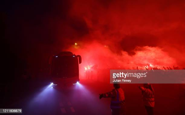 The Liverpool team coach arrives at the stadium as fans let off flares prior to during the UEFA Champions League round of 16 second leg match between...